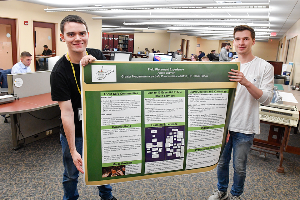 students holding poster