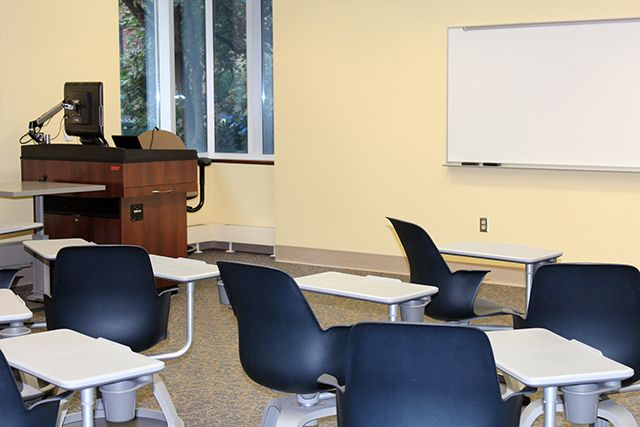 moveable chairs, instructor podium, and whiteboard.
