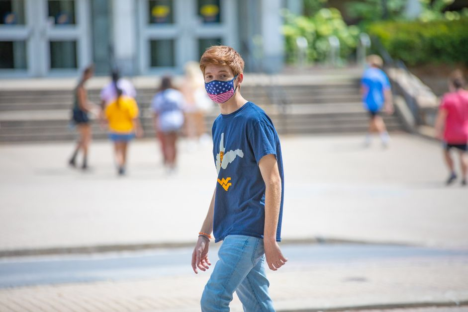 A WVU student wears a mask while on campus.