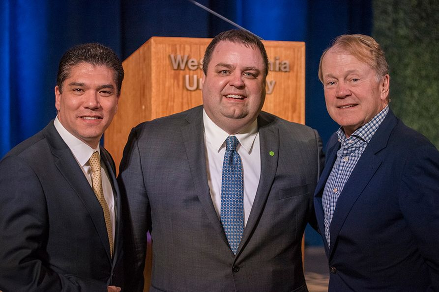 (L to R): Javier Reyes, WVU business school dean; Chad Prather, Huntington Bank's regional president for West Virginia; John Chambers, former Cisco Chairman and CEO, and WVU alumnus and for whom the business school was name