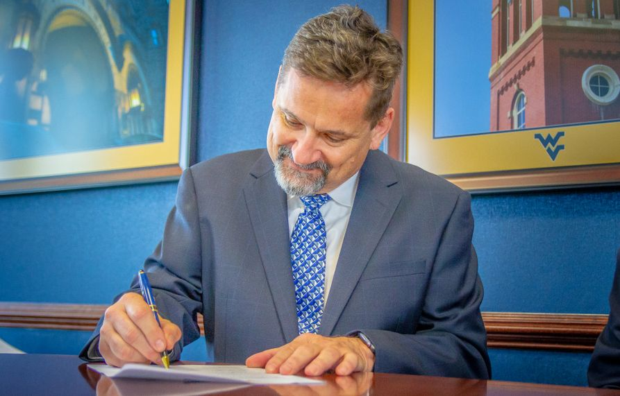 Asphalt Pavement Association of West Virginia Executive Director Pat Parsons signs a gift agreement to fund an endowed faculty chair at the Statler College of Engineering and Mineral Resources.