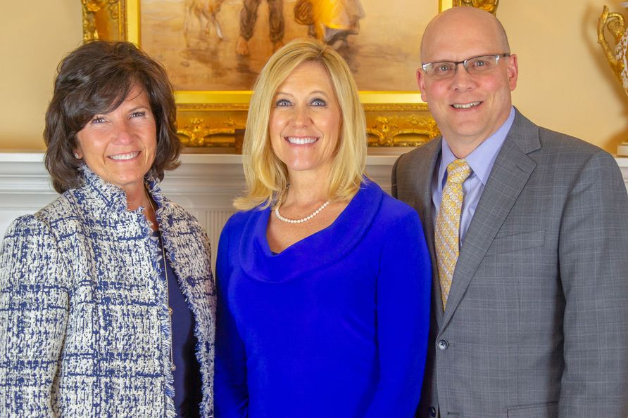 WVU Foundation President Cindi Roth is pictured with Irvin Stewart Society inductees Lydotta and Larry Taylor.