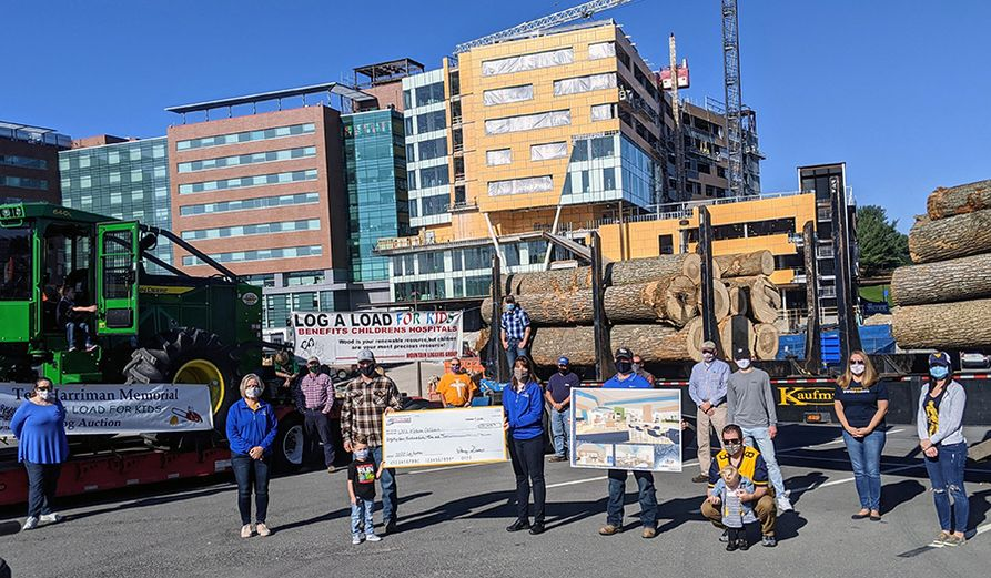 The Mountain Loggers Group presented a check to WVU Medicine Children's on Saturday, Nov. 7, following the annual Log-A-Load for Kids Auction.