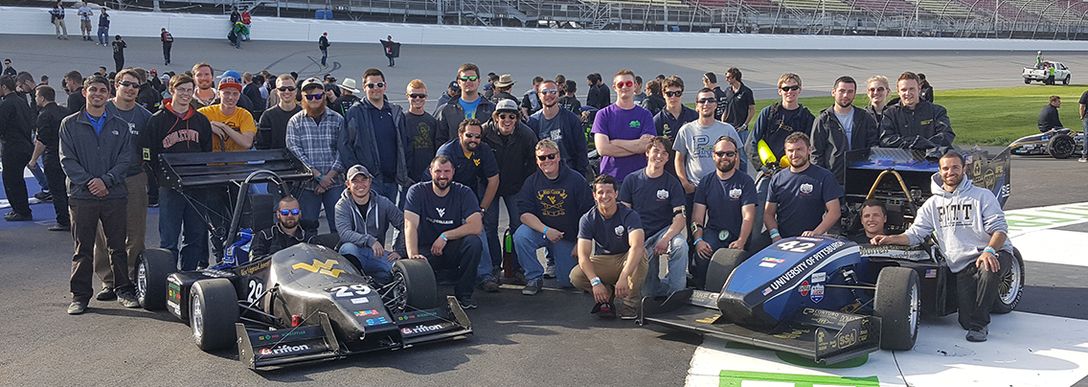 WVU and PITT FSAE Teams in the Winner Circle at Michigan International Speedway