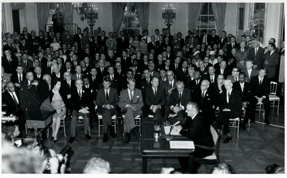 President Lyndon Johnson signing the 1964 Civil Rights Act