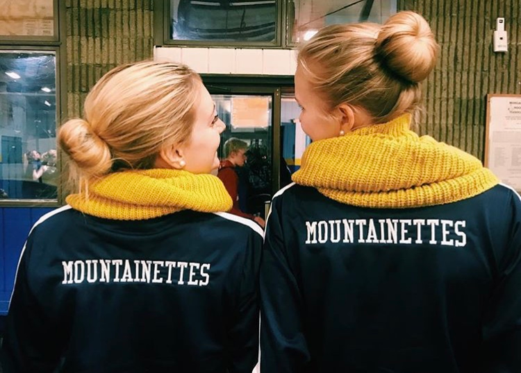 Pictured: Kristin Moro and Caroline Leadmon in their West Virginia Mountainettes gear.