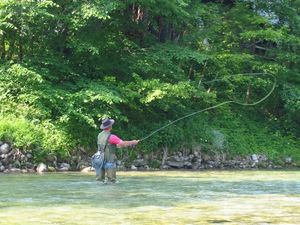 A student fly fishing at WVU Potomac State College