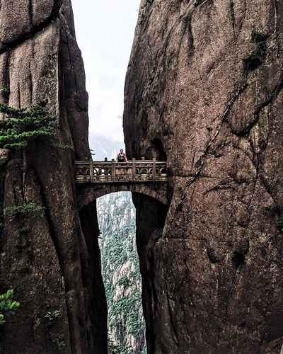 Jack Bennett, a 2016 graduate from CUMT's summer mining program, pictured on the Fairy Walking Bridge in the Huangshan mountain range.