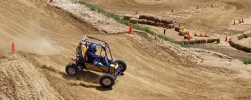 WVU Baja Car Number 99 Turning Laps in the Endurance Race.