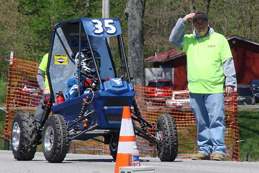 WVU stages at the starting line for the Acceleration Event at the 2013 Baja SAE Competition.