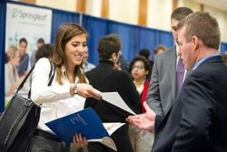 A student talks to a recruiter at the Statler College Career Fair