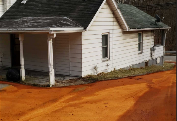 House surrounded by acid mine drainage