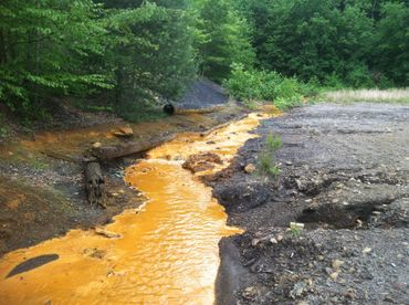 Acid mine drainage in a stream.
