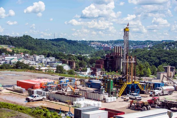 Landscape image of the Marcellus Shale Energy and Environmental Lab at the Morgantown Industrial Park overlooking the city and Mon river