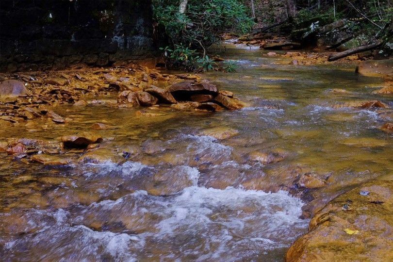 A stream with acid mine drainage in it