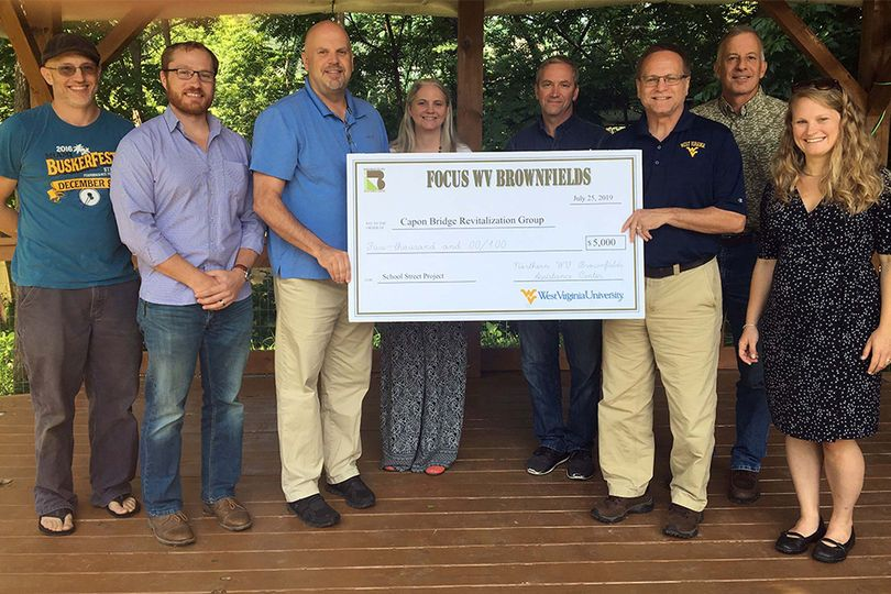 A $5,000 check is presented by the Northern West Virginia Brownsfields Center to the city of Capon Bridge for revitalization