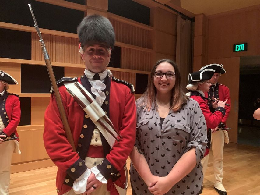 2019-2020 RAP student Elizabeth Rockwell stands with Sergeant William Parks, drum major of the US Army Old Guard.