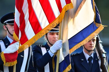 ROTC members carrying flag