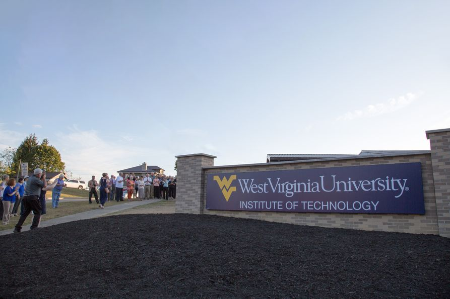 People gather for the unveiling of the new Beckley campus Welcome Wall