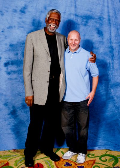 Mike McClellan stands with basketball legend, Bill Russell.