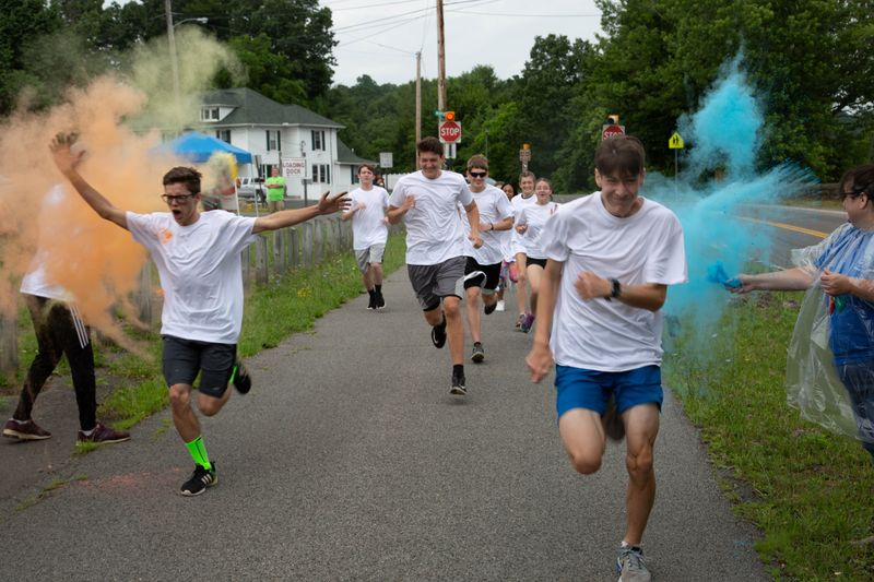 Student participate in the color run at the Upward Bound Olympics