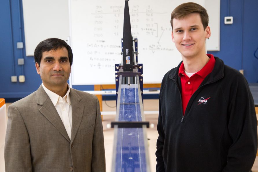 Dr. Yogendra Pants (left) stands in an engineering lab with Austen Robinson (right).