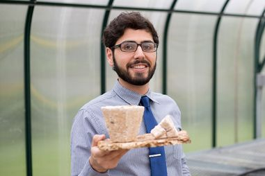 Nima shows the biodegradable materials he has made