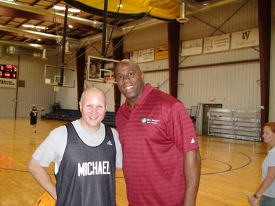 Michael at a basketball camp with Magic Johnson.