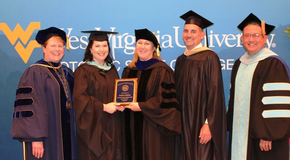 Education Professor Andrea Schafer, second from left, was named WVU Potomac State College's 2019 Outstanding Professor of the Year. Making the presentation was (from left): Campus President Jennifer Orlikoff; Sheryl Chisholm, Faculty Assembly Chair and Bi