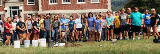 Approximately 40 West Virginia University Potomac State College students volunteered to help plant trees on campus earlier this month. The College received a Carla Hardy WV Project CommuniTree grant from Cacapon Institute to plant 24 trees around the Admi
