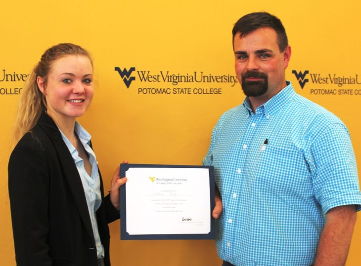 Laicey Dolly, from Mineral County, was named the senior with the highest overall score which earned her a tuition waiver to WVU Potomac State College her freshman year. Presenting her with her certificate was Equine Studies Instructor Jared Miller.