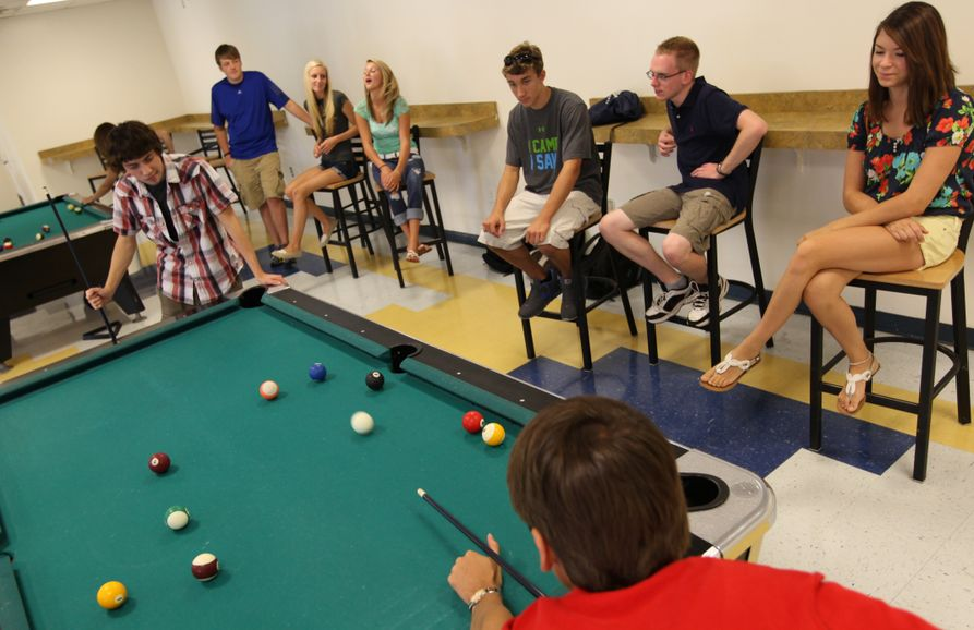 Students playing billiards at The Underground at WVU Potomac State College