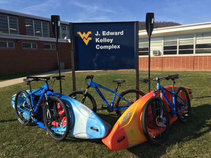 Bicycles and Kayaks, that can be rented, sitting outside of the J. Edward Kelley Complex at WVU Potomac State College