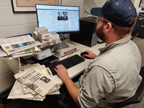 Nick Gardner, interim program coordinator for the WVU Potomac State College library, demonstrates how easily accessible some local newspapers are now that these have been digitized.