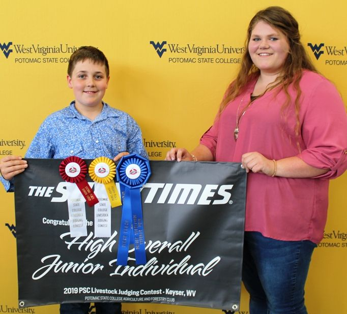 Trey Myers, a member of the Bedford County, Pa. 4-H, was named High Overall Junior Individual. His coaches are Scott and Leslie Myers. Presenting the award was WVU Potomac State College Student Maggie Waugh, a sophomore Agriculture and Environmental Educa