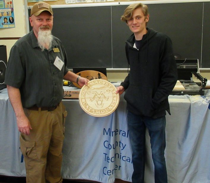 "Caption: Jim Spurling, left,  and Dillion Young presented about manufacturing processes at the 2019 Mineral County STEM Festival. This year, Spurling will present, ""Additive and Subtractive Manufacturing Processes"" with a demonstration using 3D printing a"