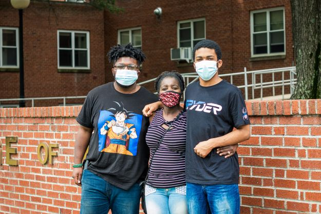 Freshman Lamont Lee, far left, on move-in day with his mom and younger brother