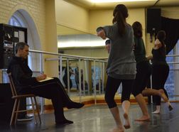 instructor teaching dance students
