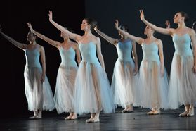 women dancers wearing white gowns