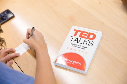 A TED Talks book sites on a table