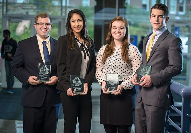 supply chain management competition team holding awards