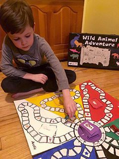 kid playing a boardgame
