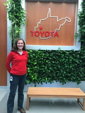 Michaela Luck standing in front of a West Virginia Toyota sign
