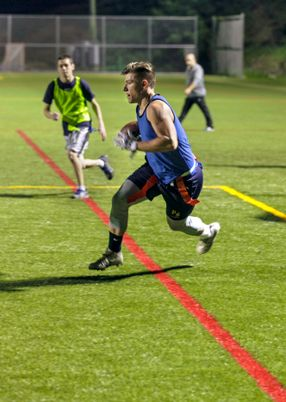 Student playing flag football at WVU Potomac State College
