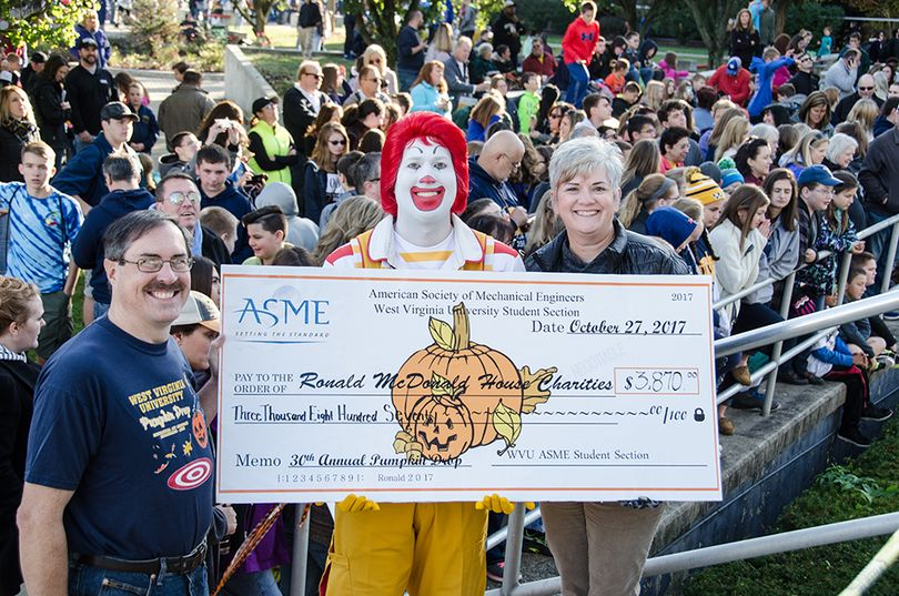 Photo of Check Presentation to Ronald McDonald House Charities with Dr. Scott Wayne, Ronald McDonald and Eleanor Reigel.
