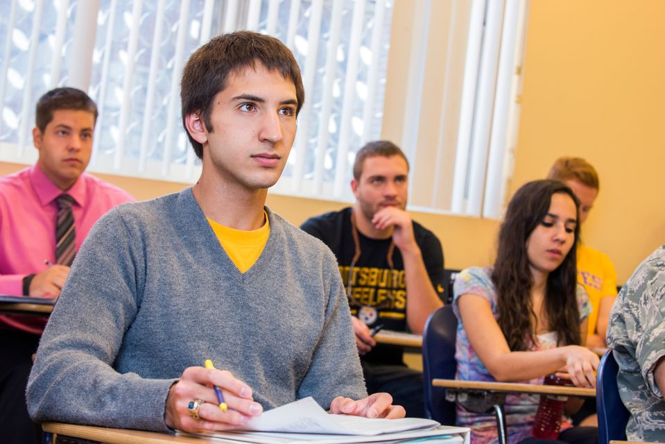 Students sitting in a classroom listening to instructor