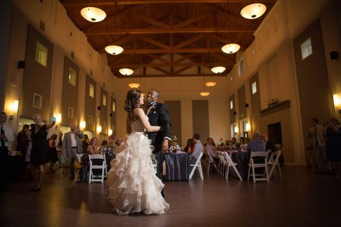 bride and groom dance in front of seated guests