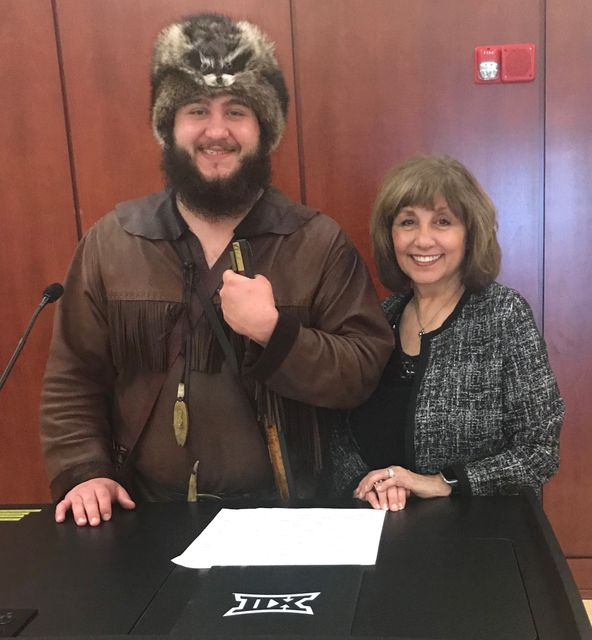 Timmy Eads, Mountaineer Mascot for 2019-20, and Dr. Carolyn Atkins review notes for Timmy's address to the Board of Governors in April 2019.