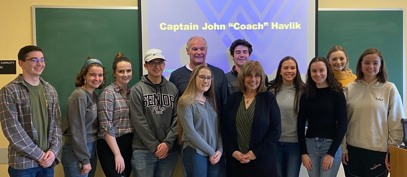 "Captain John ""Coach"" Havlik talks to the Presidential Student Ambassadors Cohort 3."