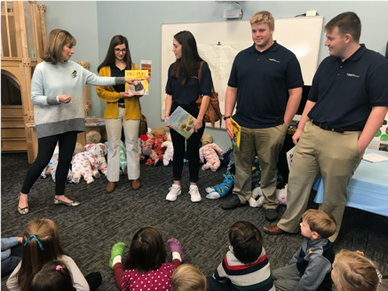 Melissa Workman introduces Giana Loretta, Meg Sorrells, Adam Stilley, and Ryan Maiden as they prepare to read stories to children at the WVU Nursery School.